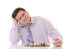 Geschäftsmann mit Münze Lizenzfreies Stockfoto