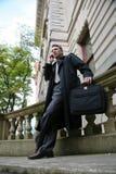 Geschäftsmann mit Mobiltelefon Stockfotografie