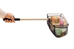 Geschäftsmann mit Netz und Geld Lizenzfreie Stockfotos
