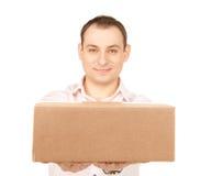 Geschäftsmann mit Paket Lizenzfreie Stockfotografie
