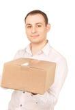 Geschäftsmann mit Paket Stockbild