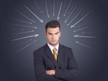 Geschäftsmann mit Pfeilen Lizenzfreies Stockfoto