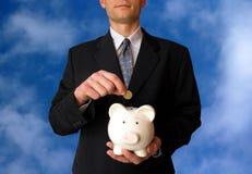 Geschäftsmann mit Piggy Querneigung Stockfotos