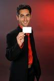 Geschäftsmann mit Plastikkarte. Lizenzfreies Stockfoto