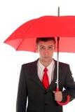 Geschäftsmann mit Regenschirm stockbild