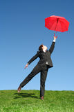 Geschäftsmann mit Regenschirm Stockfotografie
