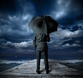 Geschäftsmann mit Regenschirm Stockfotos