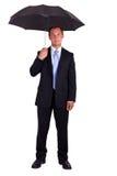 Geschäftsmann mit Regenschirm Lizenzfreie Stockfotos