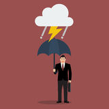 Geschäftsmann mit Regenschirm im Sturm Stockfotografie
