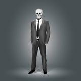 Geschäftsmann mit Schädel-Kopf Stockfoto