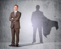 Geschäftsmann mit Schatten im Kap Stockbilder
