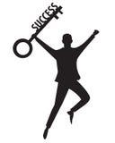 Geschäftsmann mit Schlüssel des Erfolgs Stockbild