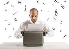 Geschäftsmann mit Schreibmaschine Stockbilder