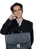 Geschäftsmann mit schwarzem leathern Kasten. Stockfotografie