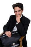 Geschäftsmann mit schwarzem leathern Kasten. Stockbild