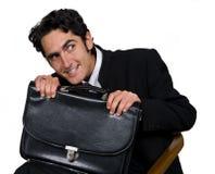 Geschäftsmann mit schwarzem leathern Kasten. Stockfotos