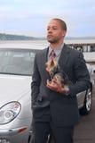 Geschäftsmann mit seinem Hund Stockfotografie