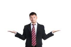 Geschäftsmann mit seinen Händen zu den Seiten Stockfoto