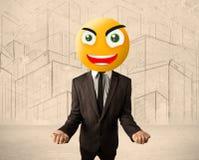 Geschäftsmann mit smileygesicht Stockbild