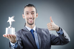 Geschäftsmann mit Sternpreis Stockbilder