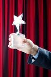 Geschäftsmann mit Sternpreis Stockfotos
