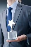 Geschäftsmann mit Sternpreis Lizenzfreies Stockbild