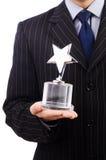 Geschäftsmann mit Sternpreis Stockfoto