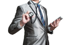 Geschäftsmann mit Stethoskop, Unternehmensanalysekonzept Lizenzfreie Stockfotografie