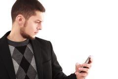 Geschäftsmann mit Telefon Stockfotografie