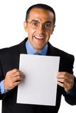 Geschäftsmann mit unbelegtem Papier Stockfoto