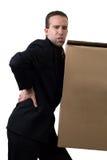 Geschäftsmann mit verletzter Rückseite Stockfoto
