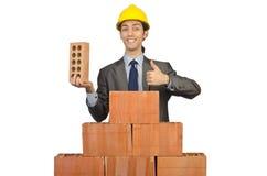 Geschäftsmann mit Ziegelsteinen Stockfoto