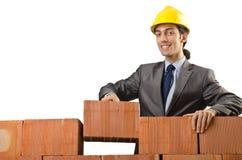 Geschäftsmann mit Ziegelsteinen Stockbild