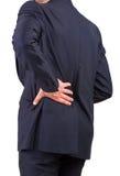 Geschäftsmann mit zurück schmerzen. Lizenzfreie Stockbilder