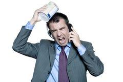 Geschäftsmann moneybox, das am Telefon schreit Lizenzfreies Stockfoto
