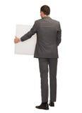 Geschäftsmann oder Lehrer mit weißem Brett von der Rückseite stockbild