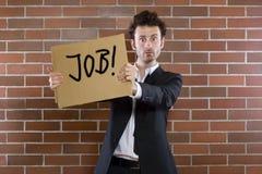 Geschäftsmann plädiert mit Zeichen   Lizenzfreies Stockfoto