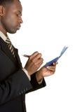 Geschäftsmann-Schreibens-Check lizenzfreies stockfoto