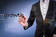 Geschäftsmann-Schreibens-Wachstum Stockbild