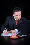 Geschäftsmann schreibt Anmerkungen Lizenzfreies Stockbild