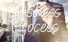 Geschäftsmann schreibt an Bord des Textes: Geschäftsprozess - mit Sonnenuntergang Stockfotos