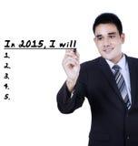 Geschäftsmann schreibt seinen Plan im Jahre 2015 Lizenzfreie Stockfotos