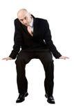 Geschäftsmann-Sitzen Stockfotos