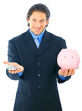 Geschäftsmann sparen Geld in der Piggy Querneigung Lizenzfreie Stockbilder