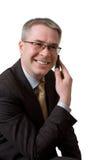 Geschäftsmann spricht durch Telefon Lizenzfreies Stockbild