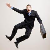Geschäftsmann springt in die Luft stockfotos