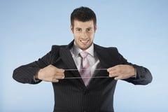 Geschäftsmann Stretching Rubber Band lizenzfreie stockfotos