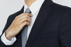 Geschäftsmann-Suit Tie Holding-Konzept Lizenzfreies Stockfoto