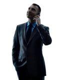 Geschäftsmann-Telefonschattenbild lokalisiert Stockfotos