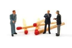 Geschäftsmann und Abgleichungen auf Weiß Stockbild